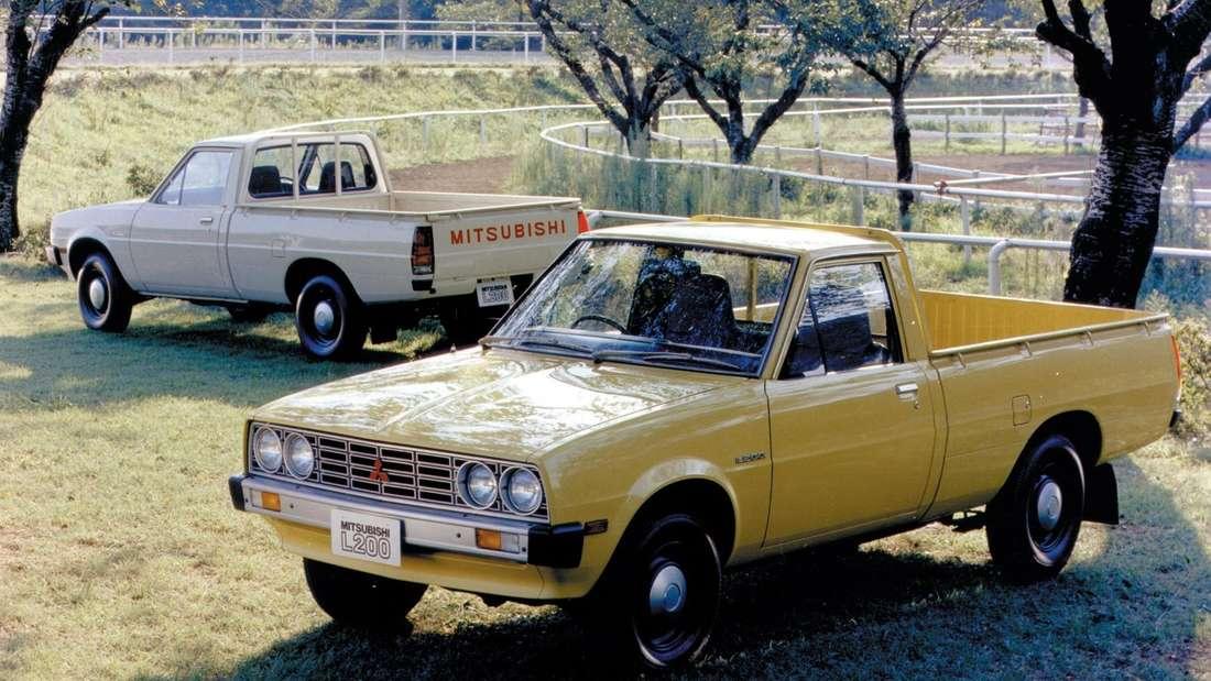 Zwei Mitsubishi L200 der ersten Generation.
