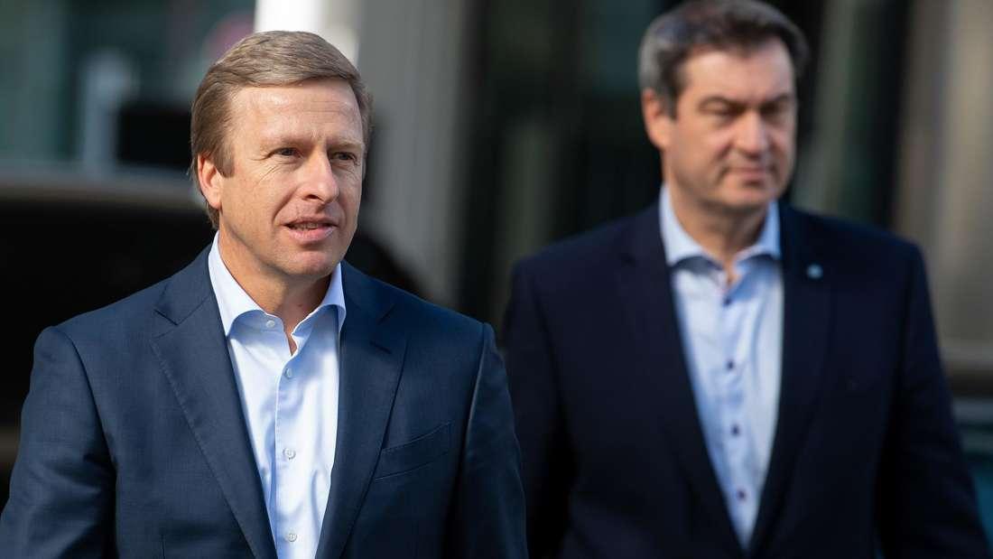 Oliver Zipse, der Vorstandsvorsitzende der BMW AG (links) und Markus Söder (rechts), der Ministerpräsident von Bayern.