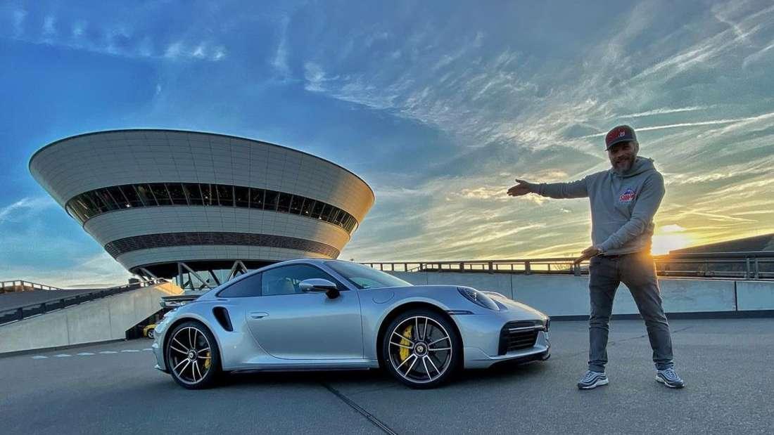 Sidney Hoffmann mit seinem Porsche 911 Turbo S im Werk Leipzig