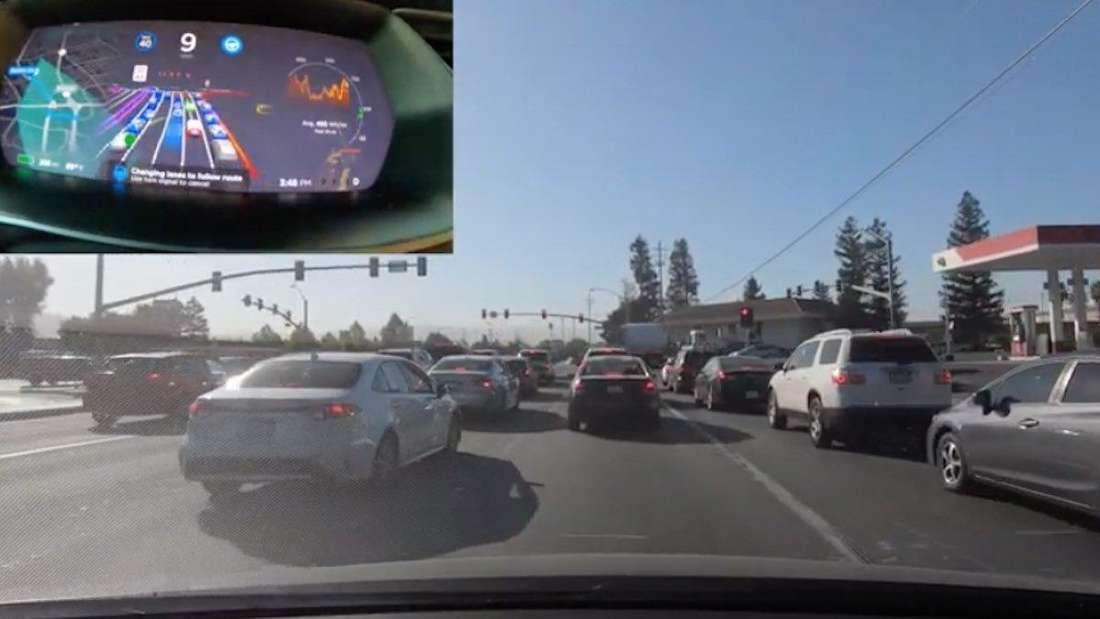 Ein Tesla-Beta-Tester filmt eine Probefahrt auf einer vielbefahrenen Straße.