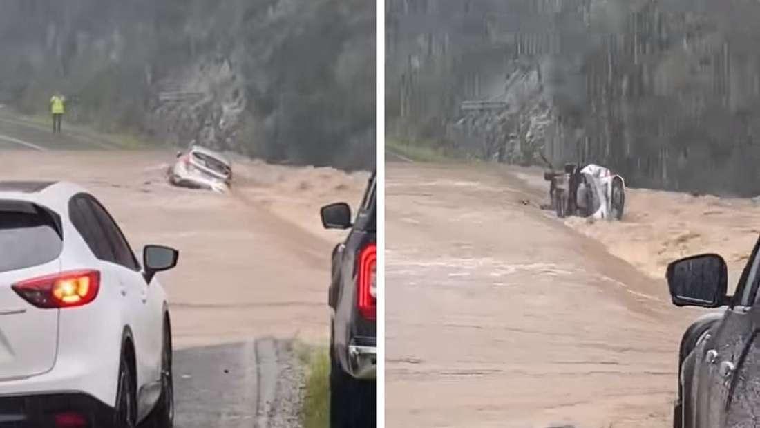 Eine Straße ist überschwemmt und ein Ford Fiesta bleibt in den Fluten stecken.