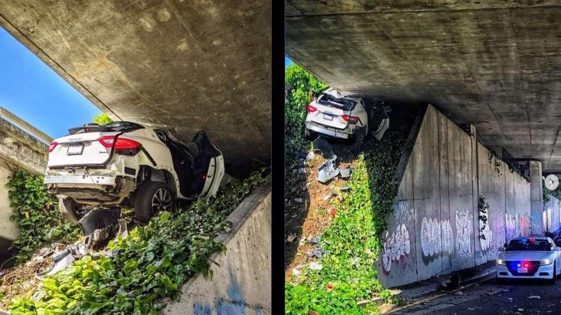 Der weiße Maserati steckt eingequetscht in einer Ecke einer Brückenunterführung fest.