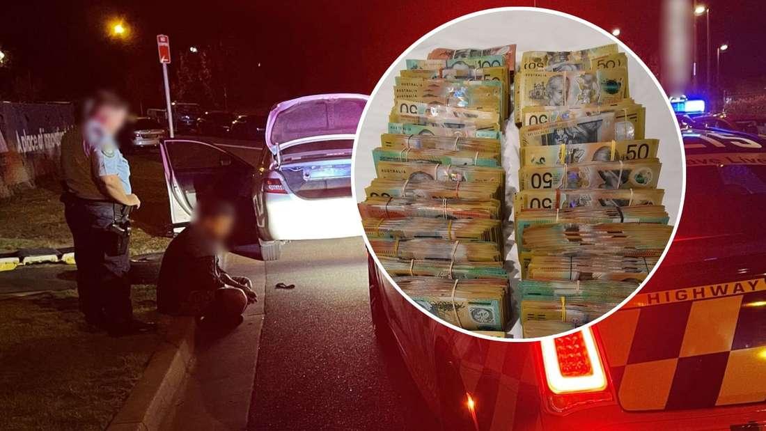 Ein Mann sitzt vor einem Polizisten am Straßenrand, eine große Summe Bargeld