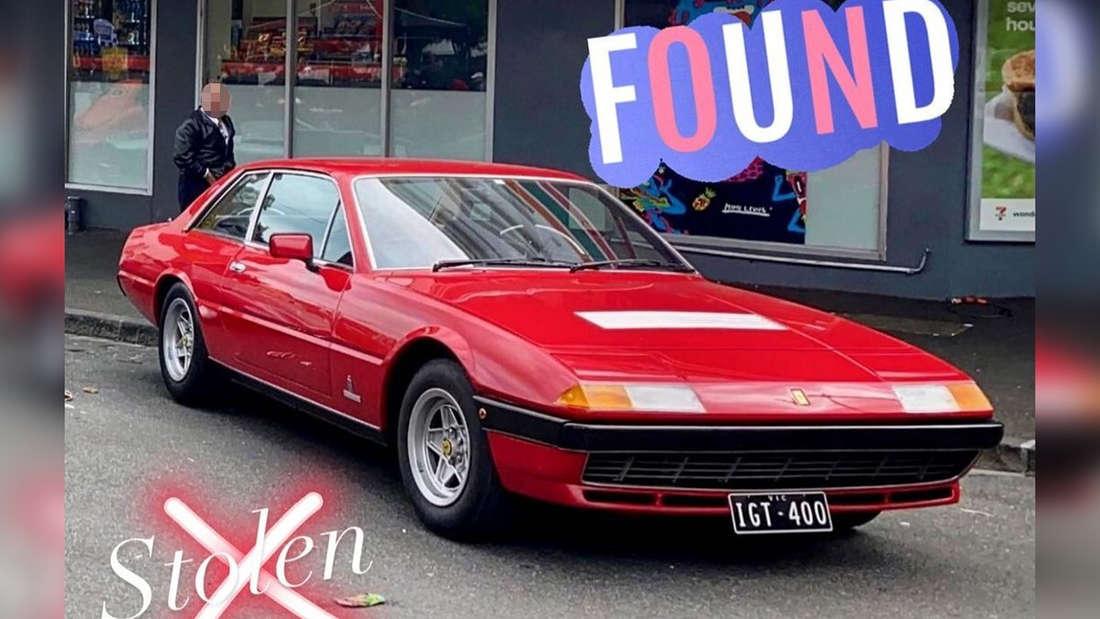 Ein roter Ferrari 400 steht auf einem Parkplatz.